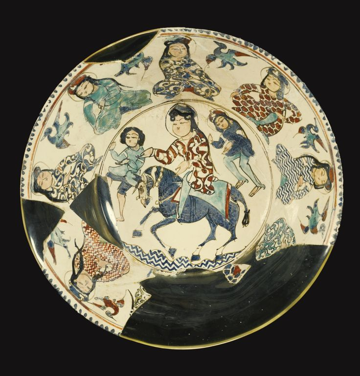 MINA'I BOWL WITH A RIDER ON HORSEBACK AND ATTENDANTS, PERSIA, LATE 12TH/EARLY 13TH CENTURY a rider on horseback in the centre accompanied by two attendants