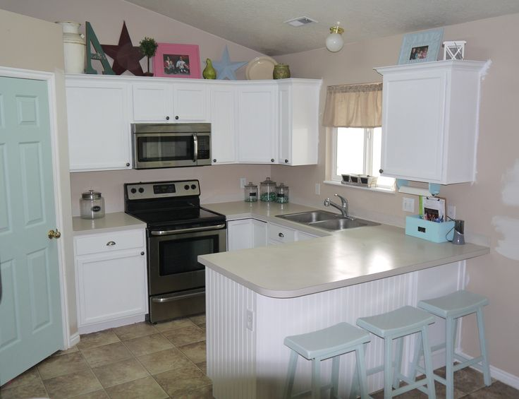 Before and after kitchen makeover with kilz primer for Best primer for painting kitchen cabinets