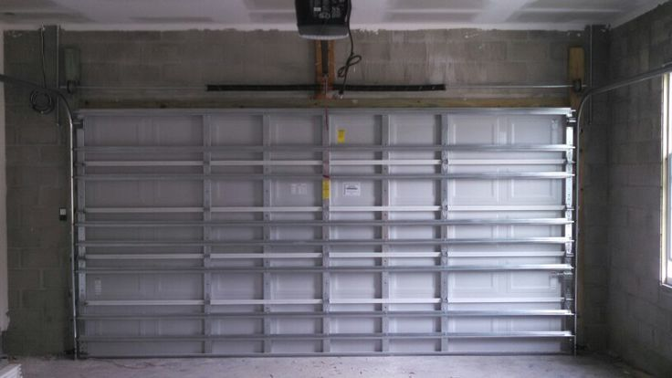 Our solid wind load garage doors are the safety and security you and your family deserve.
