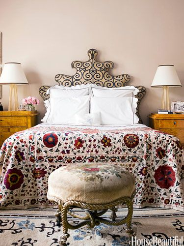 In the master bedroom, a suzani bedspread from eBay and a Venetian-inspired headboard covered in a cut velvet that looks like ironwork, add exoticism.