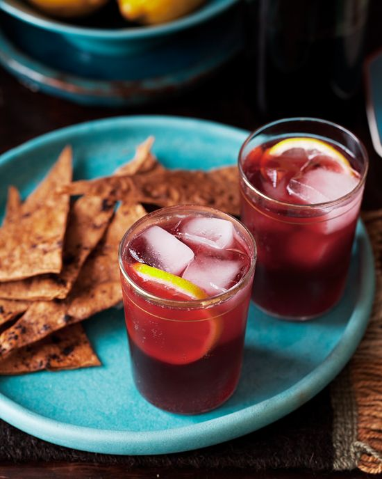Tinto de Verano: Ice cubes; 1bottle inexpensive Spanish red wine;   Sparkling lemonade; Fresh lemon slices. LITERALLY all i drink. <3 te echo de menos España