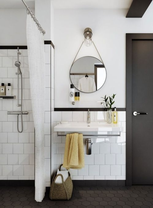 I love the grey floors trim and door painted with white tiles and walls, capped with dark trim tile.  Such a crisp white and grey bathroom!