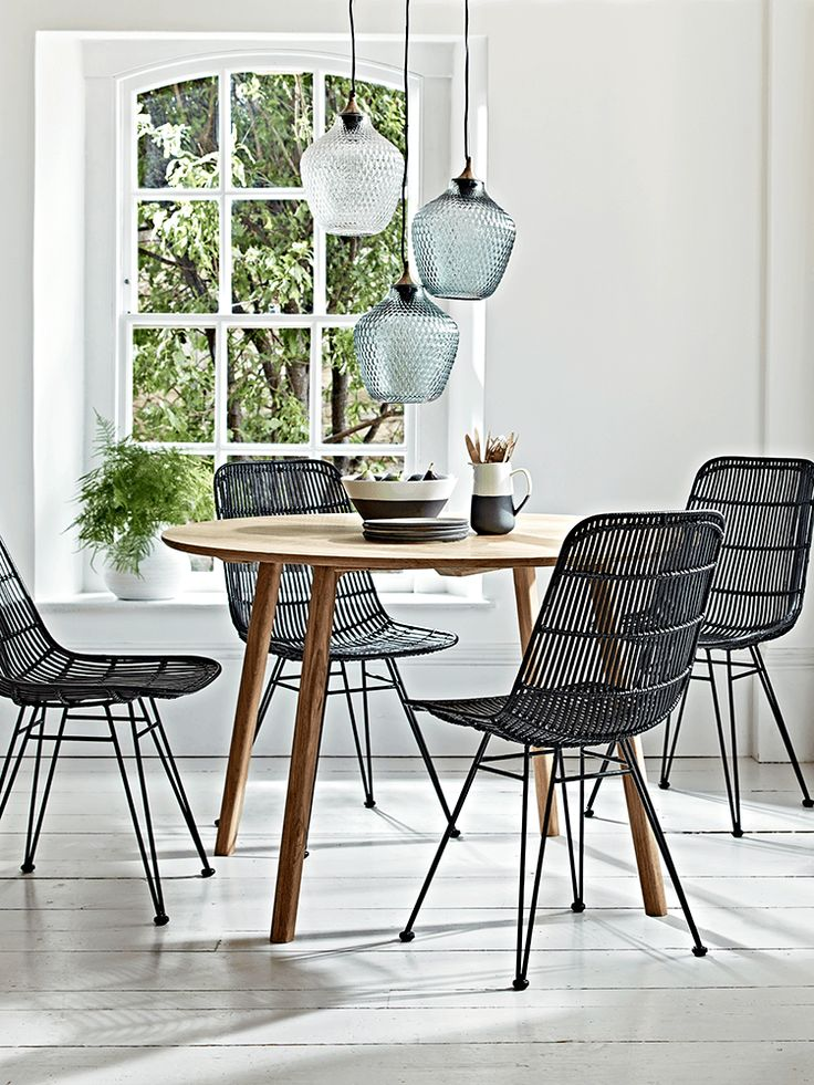 Made from handcrafted, natural oak, our elegant round table has slender legs and a beautiful, unique finish with visible wood grain. The perfect way to introduce Scandi style to your kitchen or dining room, pair with our Flat Rattan Dining Chair - Black, Monochrome Stoneware Dinnerware and Embossed Glass Pendant to recreate our look.