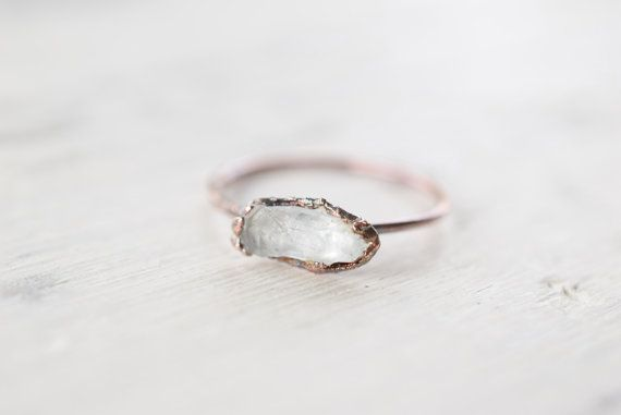 This is one of the most beautiful raw stone engagement rings I have ever seen. | Spotted via http://emmalinebride.com/planning/raw-stone-engagement-rings/