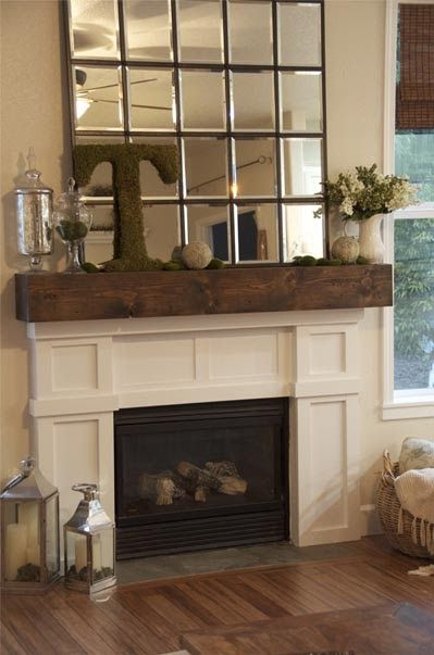 Love the rustic mantle - would fit with the floating shelves from the alcove storage pin