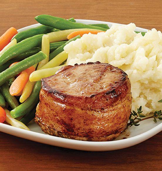 Porc bardé de bacon - Des portions de longe de porc désossée et assaisonnée, enrobées de bacon fumé. 4 unités.