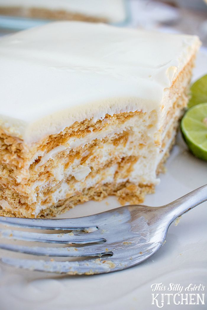 Key Lime Eclair Cake, layers of creamy filling bursting with key lime flavor between graham crackers, topped with vanilla frosting. Tastes just like a key lime pie, but much easier! from ThisSillyGirlsLife.com #keylimepie #eclaircake