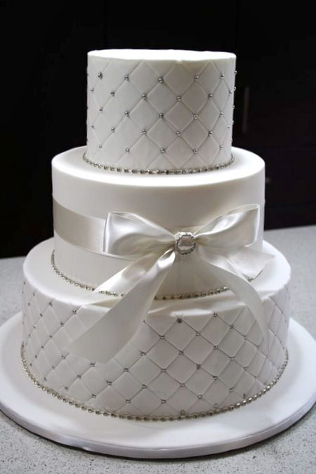 Cake by The Cake Company-I simply LOVE the way they did the diamonds on the top and bottom layers with the little gems!  So pretty!
