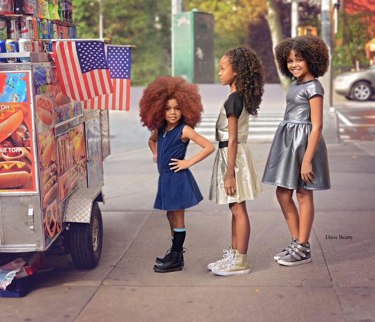portrait of stylish girls at a hot dog stand in nyc by daisy beatty photography #nyc #hotdog #hotdogstand #redlilmissy #curls #girls #childmodel
