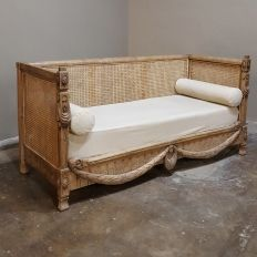 This particular 19th Century French Blonde Walnut Stripped Louis XVI Sofa ~ Canape features an elegant yet casual effect, with highly desirable unfinished blonde walnut hand-carved to perfection and blended with woven cane to produce a light and airy look.  Classical motifs handed down from the ancient Greek and Roman civilizations ensure timeless enjoyment.Circa 1880sMeasures 35H x 66W x 27D; seat 18.5H