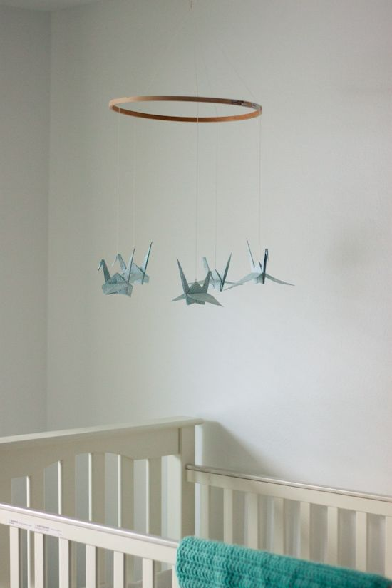 I love this idea! If you can make a paper crane, you can make this baby mobile! Great #DIY tutorial too.