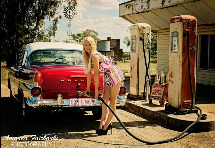 Early 60s Holden filling up at a service station of that era.