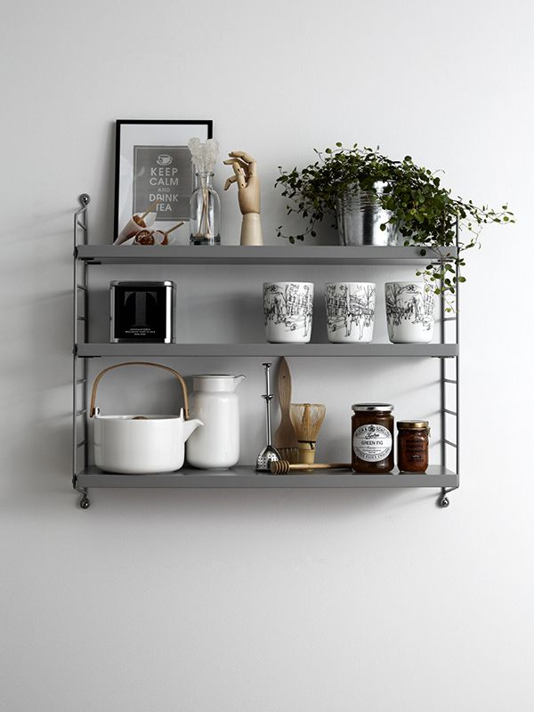 Love this simple shelf idea for the wall between the two doors in the kitchen - place at a good high level so heads don't bash into it when you run from the hall to outside!