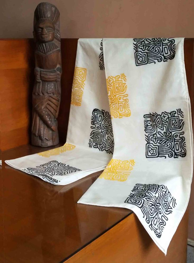 Yellow and black hand-block print on pure silk. Can be worn with a shirt or a jacket.  Size: 23 inches by 78 inches.