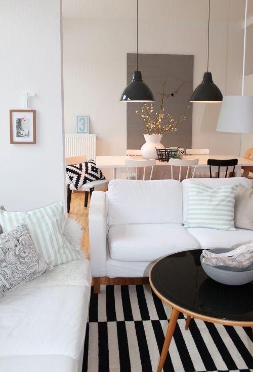 IDEAS by GALÁN SOBRINI ARQUITECTOS: Apartamentos sencillos que dividen con mobiliario las estancias abiertas y utilizan colores neutros.