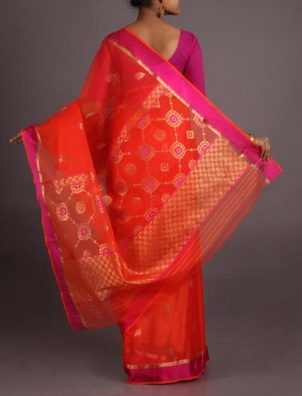 The fabric of the saree is 100% pure Kota silk          It is purely hand woven on traditional pitloom          The saree is super transparent, light textured and weightless          The checkered design called Kota khats add to its beauty          It is adorned in plain pastel color adorned in colorful motifs          The real zari motifs adds opulence and grace to the saree