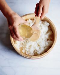 Sushi Rice Recipe on Food & Wine: Masaharu Morimoto recommends using a rice cooker and seasoning the rice to taste. Start with 1/2 cup of sweetened vinegar for every 5 cups of cooked rice, adding more by the tablespoon if desired.  Video: Morimoto Demonstrates Sushi Techniques