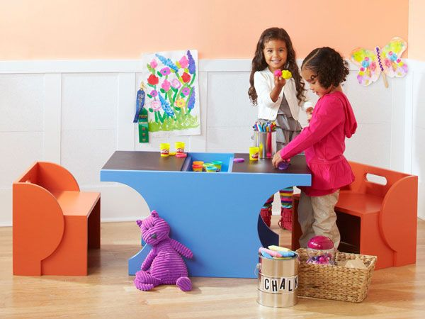 Brighten up a child's room with this colorful play set. Kids can play on the tabletop -- and you can hide the art supplies and store the benches when they're done!