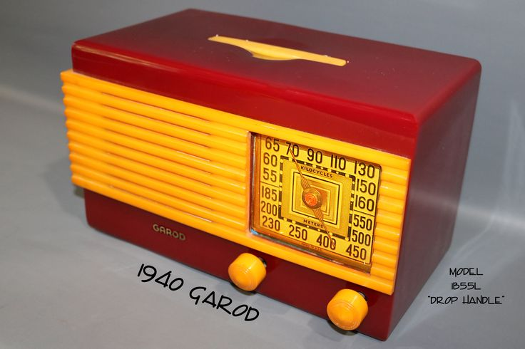 """1940 Garod model 1B55l """"Drop Handle"""" deco catalin radio, maroon with yellow trim. This deco catalin radio is unique because it is the only catalin radio that has a handle that drops flush into the cabinet. This is in perfect condition and plays."""