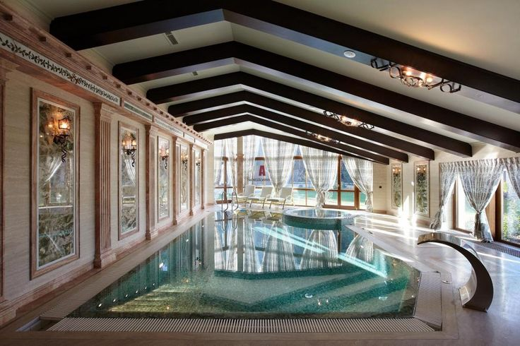 http://taizh.com/wp-content/uploads/2014/11/Appealing-swimming-pool-indoor-design-with-low-sloping-ceiling-and-wall-almp-on-the-frame-as-well-floral-curtain.jpg