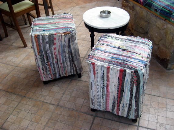 rag rugs used to cover footstools in a greek cafe