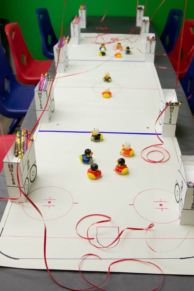 Vynal ice rink for kids to play on with there rubber duchies. Adults also signed the ice rink for a fun keepsake