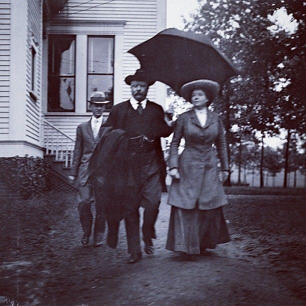 Theodore Roosevelt and Martha Berry touring Berry College on a rainy afternoon in 1910.