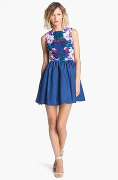 Lovely mirrored floral print fit + flare dress!