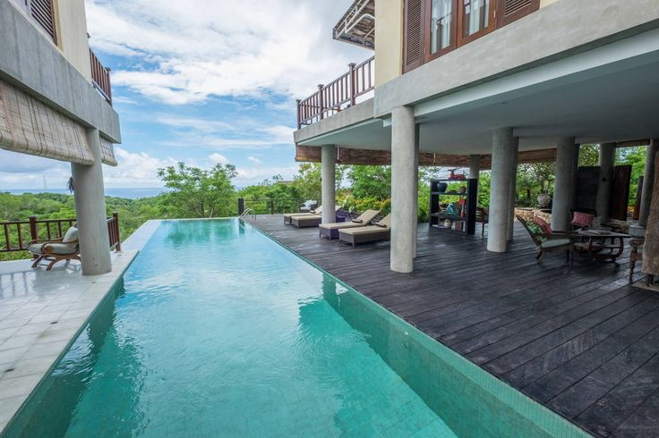 Villa in Kuta Selatan, Indonesia. A beautiful villa with a breathtaking view overlooking the South Indian Ocean.  A beautiful villa with a breathtaking view overlooking the South Indian Ocean. An infinity pool divided the villa into two areas, with a spacious living room, and dini...