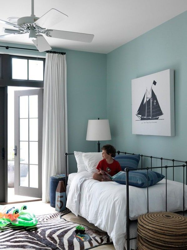Kid's bedroom with a beach theme. Love the sailboat! | Design by Mohon-Imber