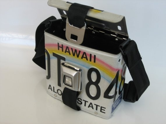 License plate purse with seatbelt buckle. Can you imagine how easy this would be to clean?