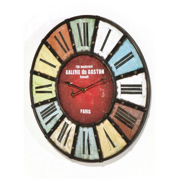 Ρολόι τοίχου Gallery colore Στρογγυλό, μεγάλο ρολόι τοίχου από σίδερο με όμορφα παλ, γήινα χρώματα. Οι αριθμοί, σε λατινικούς χαρακτήρες, διαχωρίζονται μεταξύ τους με τρόπο τέτοιο που θυμίζει κάτι από τον Πύργο του Eiffel. Είναι ιδανικό για μικρούς και μεγάλους χώρους, από τους πιο μουντούς μέχρι τους πιο χρωματιστούς! Δώστε στον χώρο σας την κομψότητα της πόλης του φωτός!   Υλικό: σίδερο, MDF