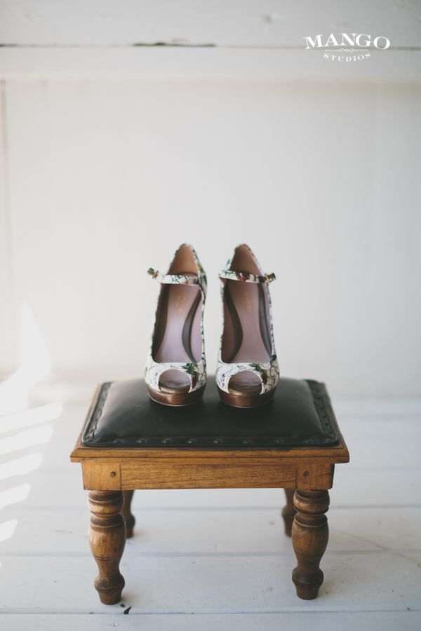Ready to be worn ! #shoes #heels #weddings #weddingideas  #white #pattern #detail #seat #wood #photography #mangostudios Photography by Mango Studios