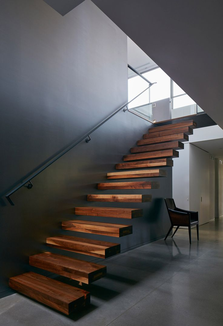 Stairs in a blackened timber and weathered