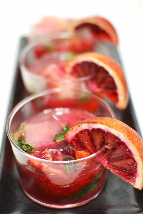 A yummy and particular San Pellegrino Blood Orange Mojitos made with rum and San Pellegrino Limonata: