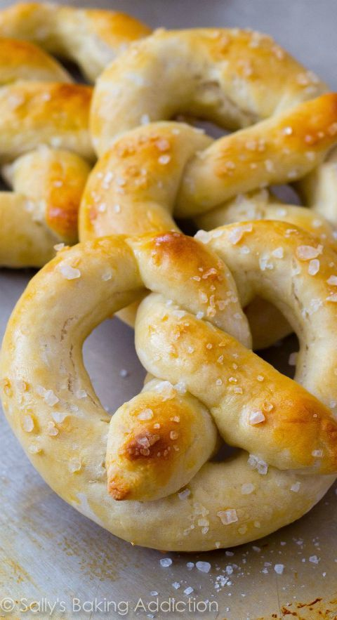 Learn how to make the EASIEST soft pretzels at home! Grab the recipe at sallysbakingaddiction.com
