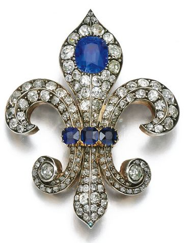 Sapphire and diamond fleur-de-lys brooch, late 19th century. Set with cushion-shaped sapphires and similarly-cut diamonds, later monogrammed to reverse.