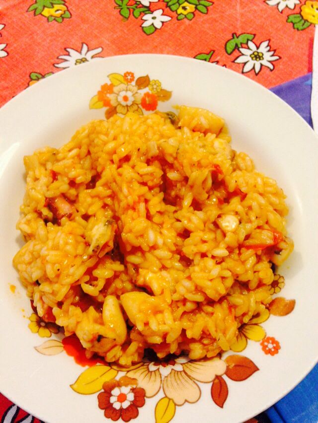Risotto alla pescatora home made dish. Full of octopus, mussels, prawns, fish and chicken.