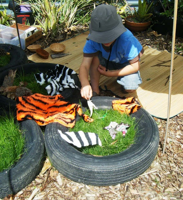Grass planted in the tyres to create play terrains
