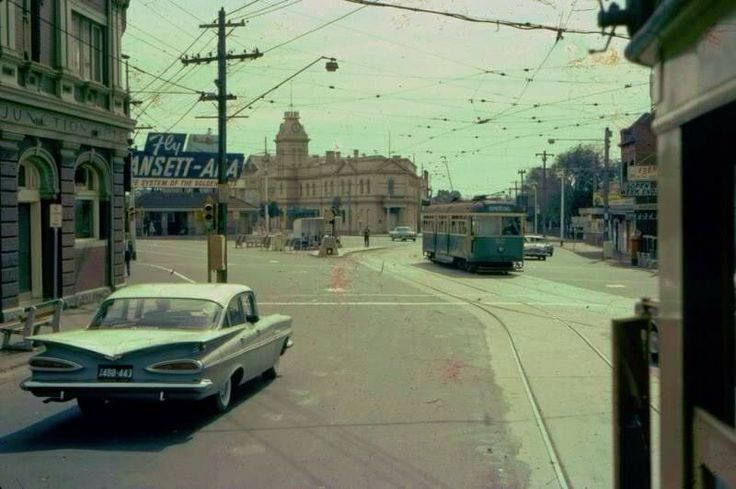 A huge Yank Tank and a tram at Moonee Ponds Junction in the 1950's.