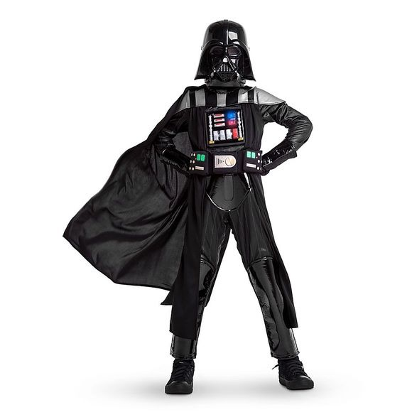 Darth Vader Light-Up Costume Kid Size 7/8 Authentic Disney Costume                       BONUS: Darth Vader Breathing device. Included. A $10 value!                                                               Tags and Disney bag included                      Worn twice   Includes bodysuit, gloves, cape and face mask Press button on upper chest to see LED lights from molded chestplate Battery pack features On switch for continuous light up Detatchable cape with self-stick fabric tabs…