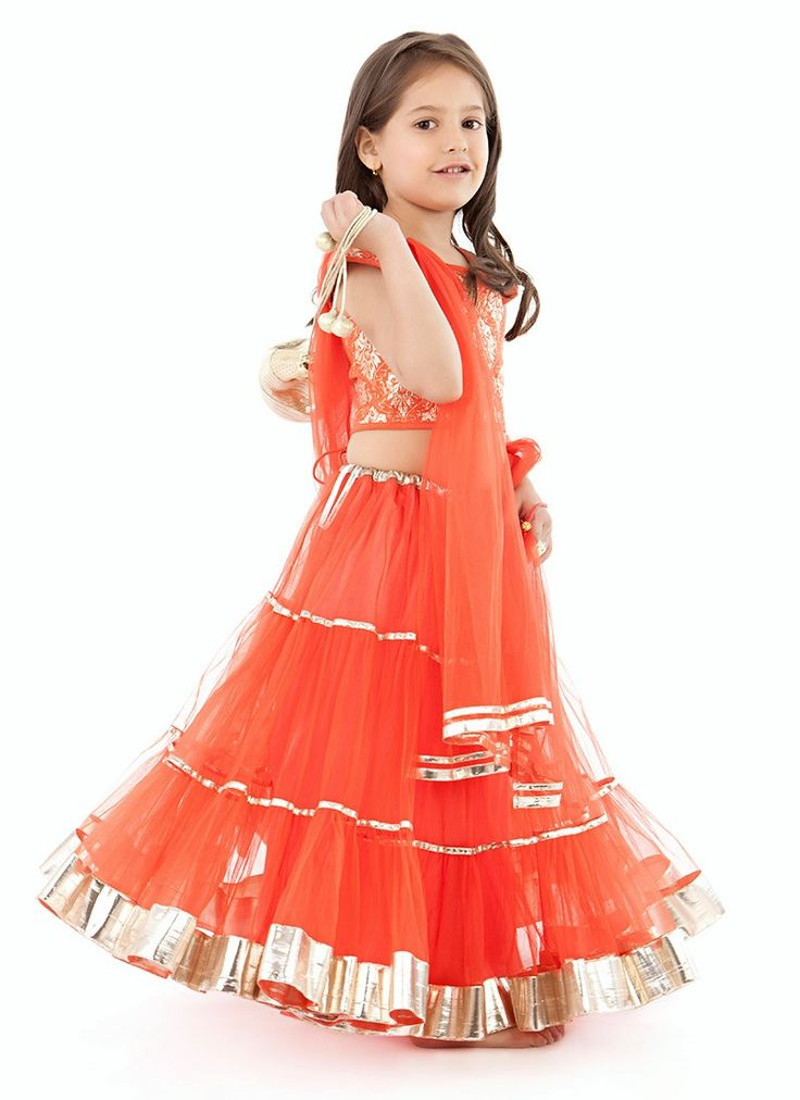 cute little girl in orange lehenga