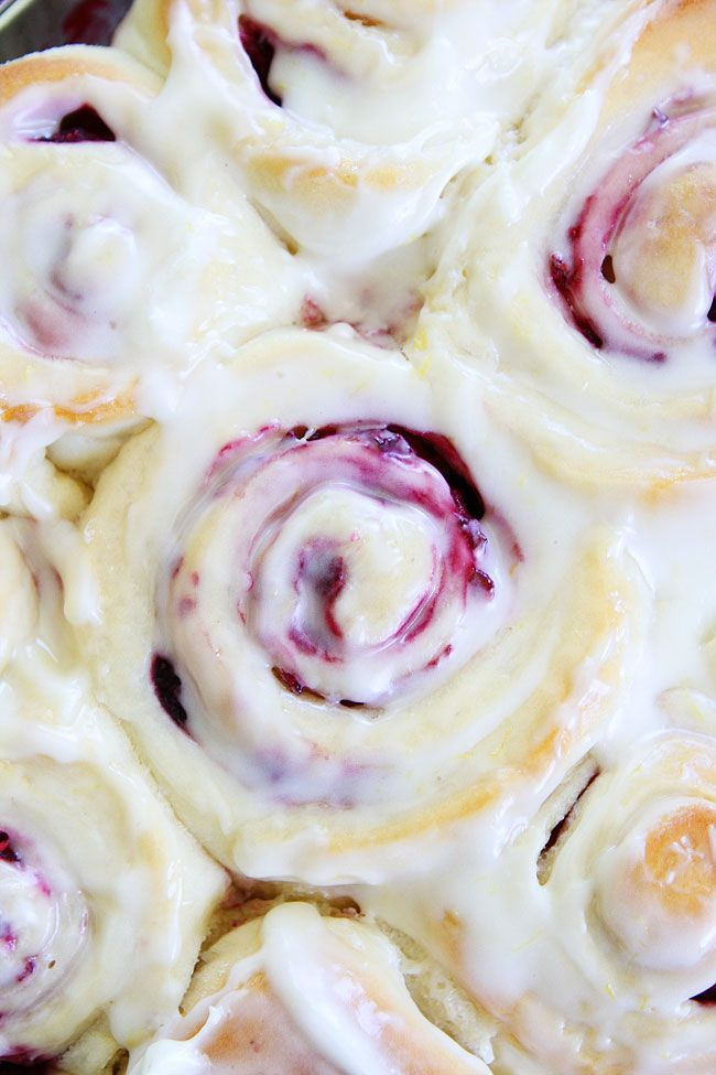 Raspberry Sweet Rolls Recipe on twopeasandtheirpod.com Soft and sweet raspberry yeast rolls topped with cream cheese frosting. These rolls are the BEST!