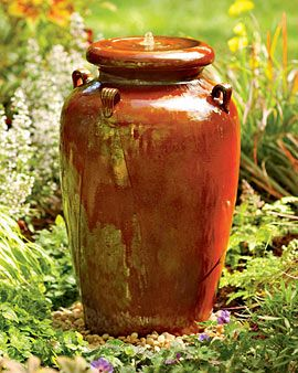 This gorgeous, burnished red stoneware urn fountain adds the subtle sound of bubbling water to your gardenscape.