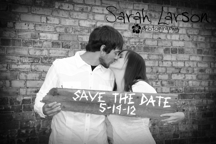 Love the sign they made for their engagement pictures