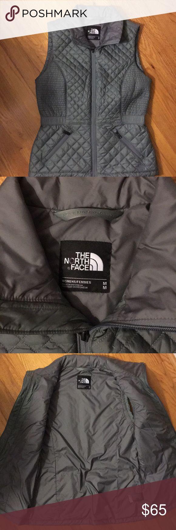 THE NORTH FACE GRAY VEST The North Face gray vest size medium. Gray quilt d vest with elastic waist. Two front zip pockets. EUC. The North Face Jackets & Coats Vests