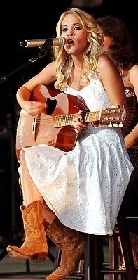 Carrie Underwood in a sundress and cowboy boots oh how I love a white Sundress and how cute with my favorite thing. Cowboy boots :)