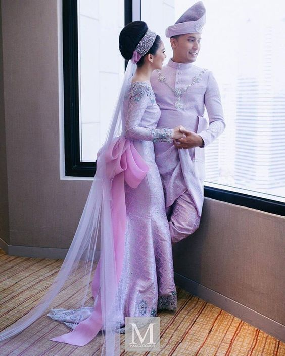 Stunning couple in traditional songket by Cosry