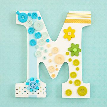 Paint a wood letter a neutral color and decorate with buttons, ribbons, and other embellishments. Perfect shower gift.