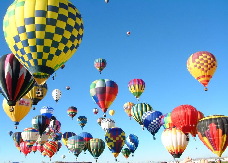 I want to go to a balloon festival and ride a balloon. (mass acensions balloon fiesta)